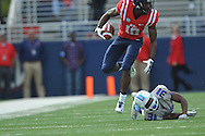 Ole Miss' Vince Sanders (10) breaks away from Presbyterian's Steve Osondu (31) to score at Vaught-Hemingway Stadium in Oxford, Miss. on Saturday, November 8, 2014. (AP Photo/Oxford Eagle, Bruce Newman)