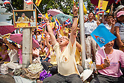 05 MAY 2010 - BANGKOK, THAILAND: A man leads a cheer for the Thai King before his motorcade passed Wednesday. Wednesday was Coronation Day in Thailand, marking the 60th anniversary of the coronation of Thai King Bhumibol Adulyade, also known as Rama IX. He is the world's longest serving current head of state and the longest reigning monarch in Thai history. He has reigned since June 9, 1946 and his coronation was on May 5, 1950, after he finished his studies. The King is revered by the Thai people. Thousands lined the streets around the Grand Palace hoping to catch a glimpse of the King as his motorcade pulled into the palace. The King has been hospitalized since September 2009, making only infrequent trips out of the hospital for official functions, like today's ceremonies.   PHOTO BY JACK KURTZ