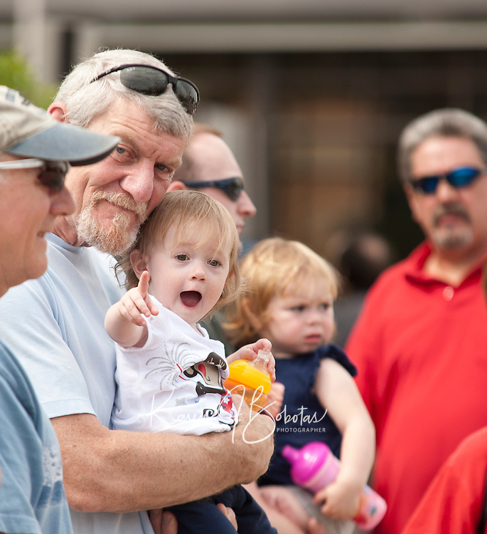 Dave Weller and Jordyn Weller await the parade during the Memorial Day festivities held downtown Laconia Sunday morning.  (Karen Bobotas/for the Laconia Daily Sun)Memorial Day parade and services in Laconia, New Hampshire  May 30, 2011.  Karen Bobotas/for the Laconia Daily Sun