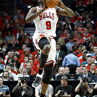 18 May 2011: Chicago Bulls small forward Luol Deng (9) takes a jumpshot from midcourt at the buzzer before halftime during the Miami Heat 85-75 victory over the Chicago Bulls, during game 2 of the Eastern Conference finals at the United Center, Chicago, Illinois, USA.