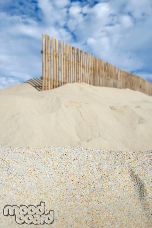 Wooden fence on sand dune