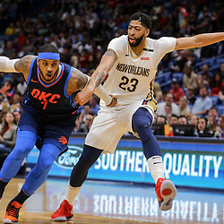 Apr 1, 2018; New Orleans, LA, USA; Oklahoma City Thunder forward Carmelo Anthony (7) drives past New Orleans Pelicans forward Anthony Davis (23) during the first quarter at the Smoothie King Center. Mandatory Credit: Derick E. Hingle-USA TODAY Sports