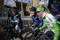 Emilie Moberg shares a joke in the sunshine at La Flèche Wallonne Femmes - a 120 km road race starting and finishing in Huy on April 19 2017 in Liège, Belgium.