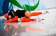 Annette Gerritsen of the Netherlands reacts after crashing in the Women's 500m speed skating competition during the 2010 Vancouver Winter Olympics at the Richmond Olympic Oval in Richmond, Canada, on Feb. 16, 2010.