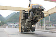 ANKANG, CHINA - APRIL 13: (CHINA OUT)<br /> <br />  A dump truck crashes into a girder on a bridge on April 13, 2016 in Ankang, Shaanxi Province of China. The driver forgot to put down the open-box bed after unloading sand. <br /> ©Exclusivepix Media