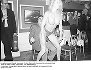 Ex policewoman Sharelle dancing at the 'Get Plastered'  Christmas Party. Groucho Club, Dean St. Soho, London. 5 December 1997<br /> Film 97696f14<br /> © Copyright Photograph by Dafydd Jones<br /> 66 Stockwell Park Rd. London SW9 0DA<br /> Tel 0171 733 0108
