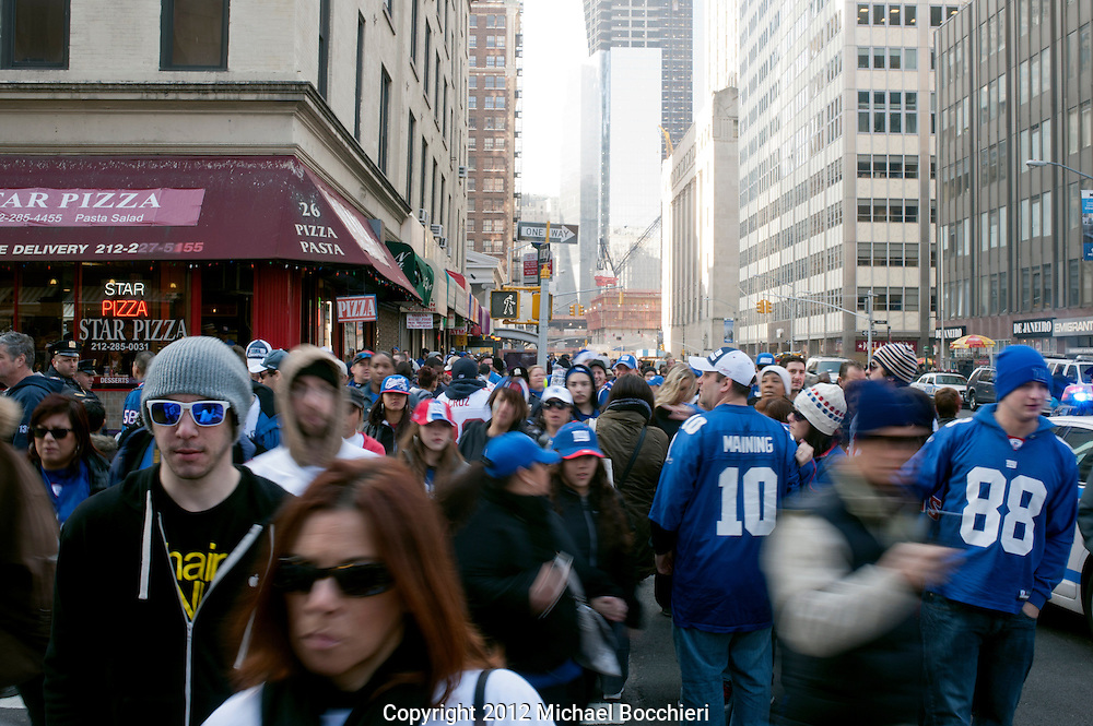 NEW YORK, NY - February 07:  People gather for the New York Giants ticker tape victory parade down the Canyon of Heros on February 7, 2012 in New York City. The Giants defeated the New England Patriots 21-17 in Super Bowl XLVI at Lucas Oil Stadium on February 5, 2012 in Indianapolis, Indiana. (Photo by Michael Bocchieri/Bocchieri Archive)