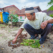 CAPTION: With poor drainage, Bandar Lampung's hilly urban environment can experience extremely high rates of surface water runoff, meaning that flooding is a major problem. Mr Fudillhah talks about the important role biopores play in reducing the severity of flooding through increasing the soil absorption rate. LOCATION: Biopores Centre, Langkapura Village, Bandar Lampung, Indonesia. INDIVIDUAL(S) PHOTOGRAPHED: Rusyamsi Fadillah.