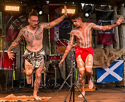Pictured: The Aborigines from Australia. at Duncarron Medieval Village Opening. Carron Valley Forest, Lanarkshire, 18 May 2019. In authentic Scottish weather, The Clanranald Trust opens a full-scale replica of an early Medieval Fortified Village typical of a Scottish Clan Chief's residence. The open air museum includes traditional buildings such as round houses, a great hall, and tower. The event features music bands and traditional dance. <br /> Sally Anderson | EdinburghElitemedia.co.uk