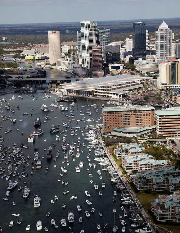 Tampa,FL.-Boats invade the channel in Tampa during the invasion of Gasparilla Saturday. (Scott Iskowitz/ The Tampa Tribune) .
