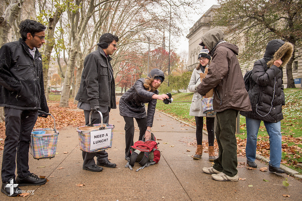 Student volunteers (from left), Deepak Gopalakrishnan, Brandon Price, Kristi Nowak and Emma Victorelli (pictured, at left) from First Trinity Evangelical–Lutheran Church deliver sandwiches to the homeless on Sunday, Nov. 20, 2016, in Pittsburgh. LCMS Communications/Erik M. Lunsford