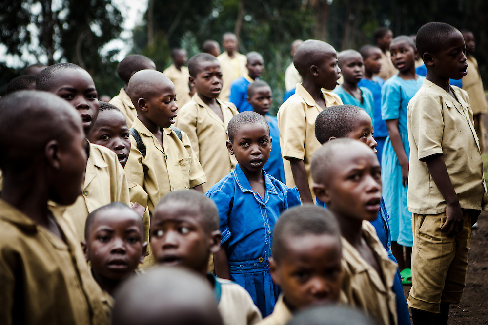 Sandrine lines up with other children outside of school in the morning. Shingiro District, Rwanda