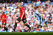 Manchester United Women forward Leah Galton (11) passes the ball during the FA Women's Super League match between Manchester City Women and Manchester United Women at the Sport City Academy Stadium, Manchester, United Kingdom on 7 September 2019.
