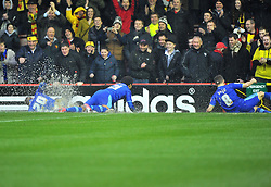 Watford players slide in the water on the pitch towards the watfard fans after Referee Michael Naylor calls the game off - Photo mandatory by-line: Joe Meredith/JMP  - Tel: Mobile:07966 386802 26/12/2012 - Bristol City v Watford - SPORT - FOOTBALL - Championship -  Bristol  - Ashton Gate Stadium -