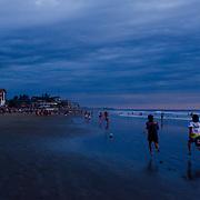 A race on the beach after sunset in Montañita, Ecuador.