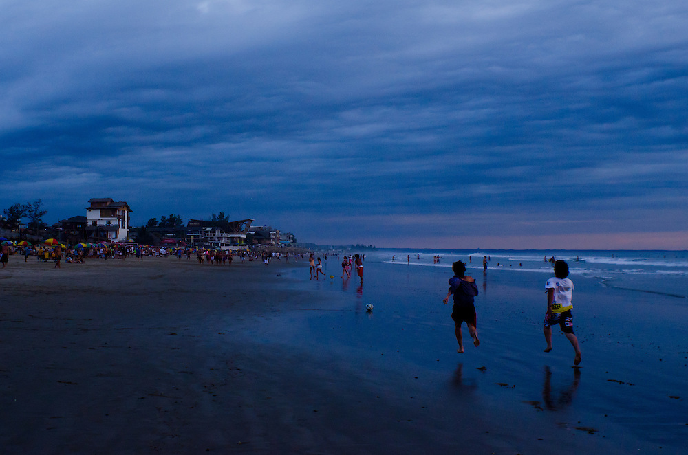 A race on the beach after sunset in Montañita, Ecuador.