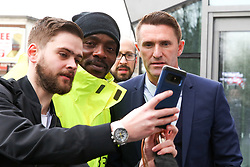 © Licensed to London News Pictures. 03/04/2019. London, UK. A Spurs fan takes a selfie with Robbie Keane (R), former Irish footballer as he arrive at the £400 million new stadium as Tottenham Hotspurs play their first competitive game against Crystal Palace this evening. Photo credit: Dinendra Haria/LNP