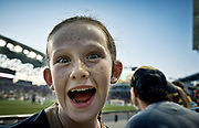 Girl making a funny face for the camera at a pro soccer game.