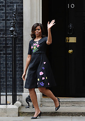© Licensed to London News Pictures. 16/06/2015. <br /> LONDON, UK. First Lady MICHELLE OBAMA departs Downing Street after a visit to have tea with David and Samantha Cameron, London, Tuesday 16 June 2015. Photo credit : Hannah McKay/LNP