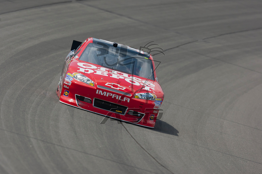 KANSAS CITY, KS - APR 20, 2012:  Tony Stewart (14) brings his car through the turns during a practice session for the STP 400 at the Kansas Speedway in Kansas City, KS.