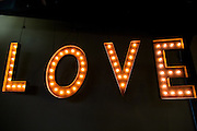 LOVE letters, tungsten lightbulbs hanging from ceiling