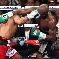 LAS VEGAS, NV - SEPTEMBER 13: Marcos Maidana (L) lands a heavy punch to the face of Floyd Mayweather Jr. during their WBC/WBA welterweight title fight at the MGM Grand Garden Arena on September 13, 2014 in Las Vegas, Nevada. (Photo by Alex Menendez/Getty Images) *** Local Caption *** Floyd Mayweather Jr; Marcos Maidana
