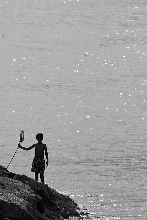 Young fisherman in Menton, France