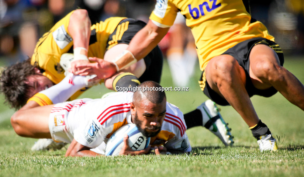 Chief's Patrick Osborne is tackled to the ground during the preseason Super Rugby match between the Hurricanes and the Chiefs, Mangatainoka Rugby Football Club, Mangatainoka,  New Zealand. Saturday, 16 February, 2013. Photo: Bethelle McFedries / photosport.co.nz