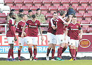 team-mate mob Alex Revell of Northampton Town after he scores during the EFL Sky Bet League 1 match between Northampton Town and Scunthorpe United at Sixfields Stadium, Northampton, England on 14 January 2017. Photo by Andy Handley.