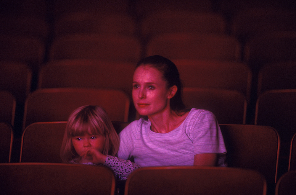 USA, Washington, Seattle, Mother and young daughter watch Pacific Northwest Ballet performance of Coppélia