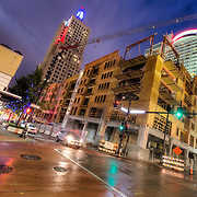 New residential construction underway in downtown Kansas City, Missouri along Baltimore Street - new supplementary apartment units to the renovation and conversion of old Power and Light Building art deco office highrise into residential apartments.