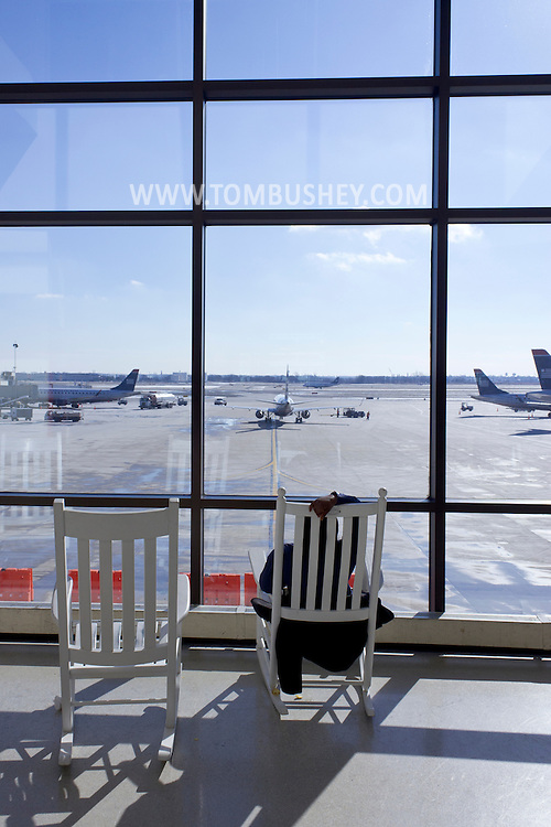 Philadelphia, Pennsylvania - A woman sits in a rocking chair while waiting for her flight at Philadelphia International Airport on Jan. 26, 2013.