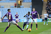 Coventry City midfielder Gael Bigirimana  takes on Port Vale defender Richard Duffy  during the Sky Bet League 1 match between Coventry City and Port Vale at the Ricoh Arena, Coventry, England on 26 December 2015. Photo by Simon Davies.