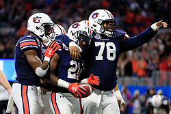 Auburn Tigers running back Kerryon Johnson (21) celebrates a touchdown during the 2018 Chick-fil-A Peach Bowl NCAA football game against the UCF Knights on Monday, January 1, 2018 in Atlanta. (Paul Abell / Abell Images for the Chick-fil-A Peach Bowl)