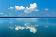Clouds reflected in Simonhouse Lake, SImonhouse, Manitoba, Canada