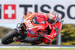 © Licensed to London News Pictures. 19/10/2012. Nicky Hayden (USA) riding for the Ducati Team during the Qualifying day of the round 16 2013 Tissot Australian Moto GP at the  Phillip Island Grand Prix Circuit Victoria, Australia. Photo credit : Asanka Brendon Ratnayake/LNP