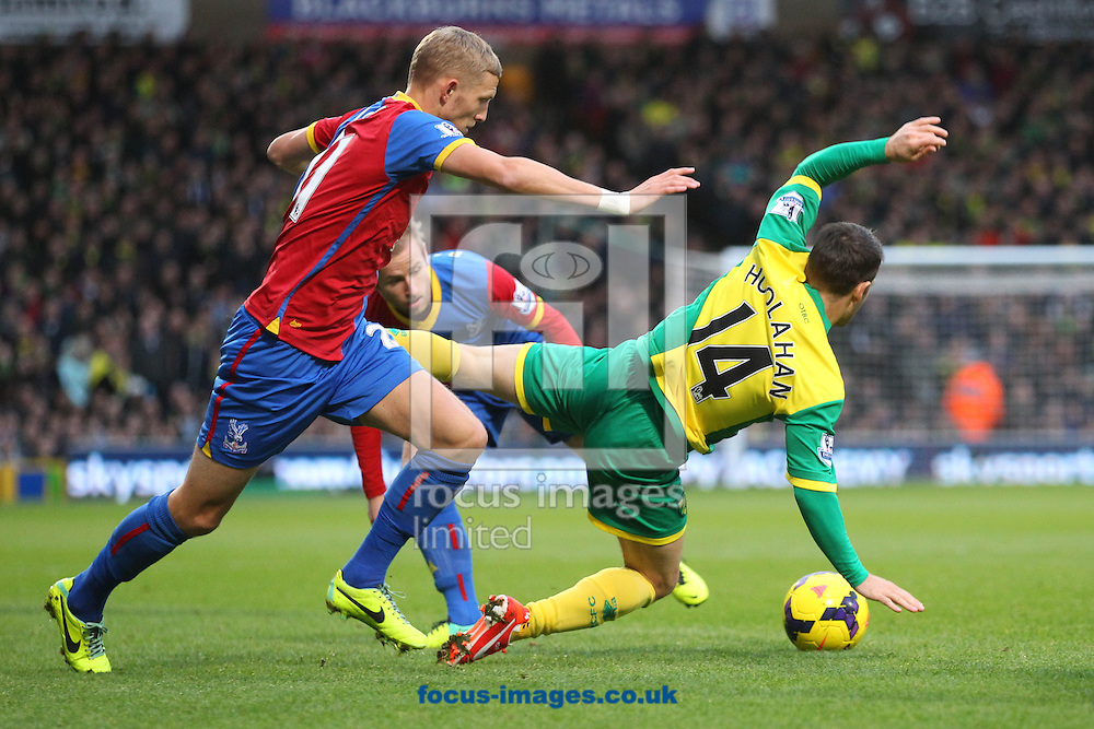 Picture by Paul Chesterton/Focus Images Ltd +44 7904 640267<br /> Wes Hoolahan of Norwich is fouled by Dean Moxey of Crystal Palace during the Barclays Premier League match at Carrow Road, Norwich.