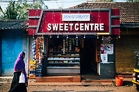 Alleppey, India -- February 18, 2018: Traditional Indian sweets for sale at a small shop.