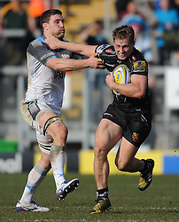 Sam Hill of Exeter Chiefs goes through Callum Green of Newcastle Falcons.  - Mandatory byline: Alex Davidson/JMP - 12/03/2016 - RUGBY - Sandy Park -Exeter Chiefs,England - Exeter Chiefs v Newcastle Falcons - Aviva Premiership
