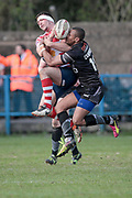 Jonathon Campbell (Bradford Bulls) collects man and ball in the air during the Kingstone Press Championship match between Oldham Roughyeds and Bradford Bulls at Bower Fold, Oldham, United Kingdom on 2 April 2017. Photo by Mark P Doherty.