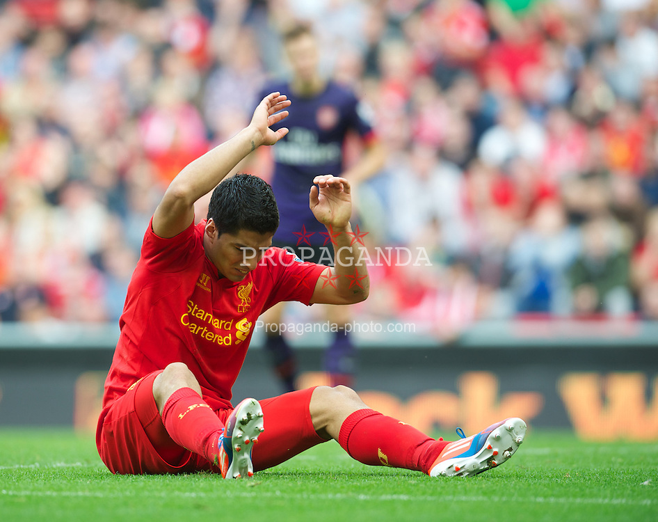 LIVERPOOL, ENGLAND - Sunday September 2, 2012: Liverpool's Luis Alberto Suarez Diaz looks dejected as his side lose 2-0 to Arsenal during the Premiership match at Anfield. (Pic by David Rawcliffe/Propaganda)