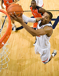 Virginia forward Mike Scott (32) grabs a rebound against Auburn.  The Auburn Tigers defeated the Virginia Cavaliers 58-56 at the University of Virginia's John Paul Jones Arena  in Charlottesville, VA on December 20, 2008.  (Special to the Daily Progress / Jason O. Watson)
