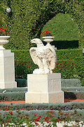"Stone eagle in the gardens around the Shrine of Bahaullah Acre. Israel<br /> The most holy spot in the Bah?'? world: Bahji, near Acre, Israel, the resting place of Bah?'u'll?h's earthly remains. Surrounded by gardens, the mansion of Bahji (Arabic for ""delight"" or ""joy"") is visited by thousands of pilgrims every year. Their focus is the small garden house to the right of the main mansion, where Bah?'u'll?h's physical remains are buried."