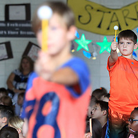 Jack Warriner Barnes, a third grader at Saltillo Elementary School, holds up a Ping Pong Ball on a Pencil toward the window light as he learns the phases of the moon from visiting guest speaker Bob Swanson, ICC Astronomy Insctuctor Wednesday morning. Swanson visited the school to teach students about the upcoming eclipse.