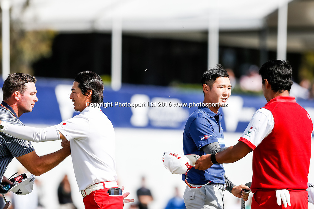 Team NZ and and Team Japan shale hands at the end of their round during the round 1 of the World Cup of Golf at Kingston Heath Golf Club, Melbourne Australia. Thursday 24th November 2016. Copyright Photo Brendon Ratnayake / www.photosport.nz