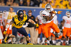 Oct 10, 2015; Morgantown, WV, USA; Oklahoma State Cowboys running back Chris Carson makes a catch across the middle of the field during the first quarter against the West Virginia Mountaineers at Milan Puskar Stadium. Mandatory Credit: Ben Queen-USA TODAY Sports