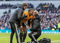 Football - 2019 / 2020 Premier League - Tottenham Hotspur vs. Wolverhampton Wanderers<br /> <br /> Adama Traore (Wolverhampton Wanderers) gets treatment for his injured shoulder at The Tottenham Hotspur Stadium.<br /> <br /> COLORSPORT/DANIEL BEARHAM