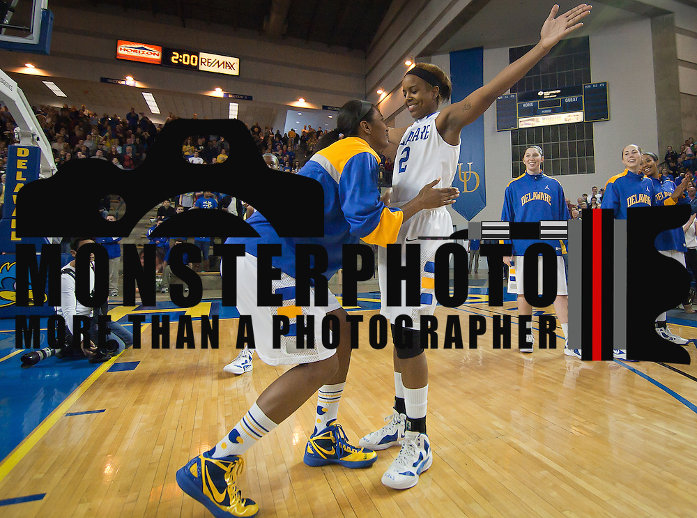Delaware Senior Guard Jocelyn Bailey (2) (Right) get padded down by teammate Delaware Forward Danielle Parker (12) during player introductions prior the start of a Colonial Athletic Association conference Basketball Game against Northeastern Sunday, Feb. 26, 2012, at the Bob Carpenter Center in Newark, Del.