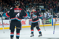 KELOWNA, CANADA - DECEMBER 3: Nick Merkley #10 and Madison Bowey #4 of Kelowna Rockets celebrate a goal against the Saskatoon Blades on December 3, 2014 at Prospera Place in Kelowna, British Columbia, Canada.  (Photo by Marissa Baecker/Shoot the Breeze)  *** Local Caption *** Nick Merkley; Madison Bowey;