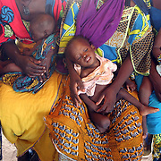 August 4, 2005 - Women wait for their children to be weighed and measured to check for malnourishment at a Doctors Without Borders feeding center in Maradi, Niger. Photo by Evelyn Hockstein/Polaris
